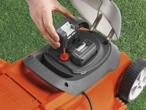 Loading battery into lawn mower